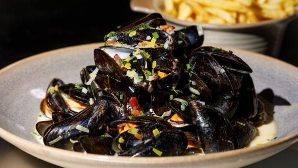 River Exe mussels, pancetta, leek, Somerset cider, fries